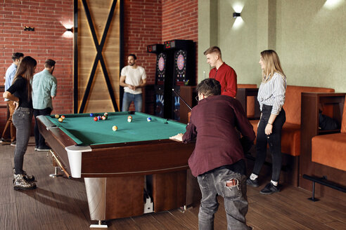 Friends playing billiards together - ZEDF02034