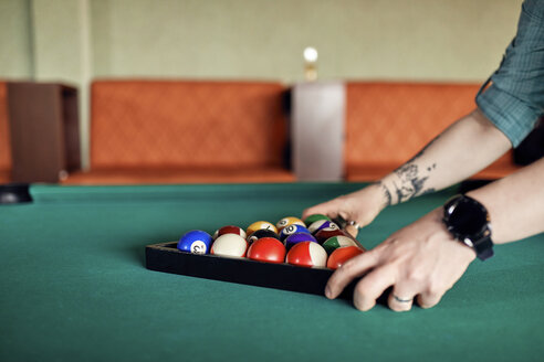 Close-up of billiards player arranging balls on table - ZEDF02043