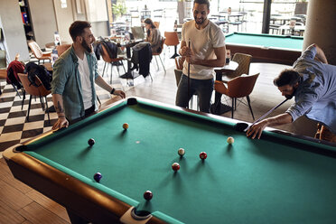 Friends playing billiards together - ZEDF02049