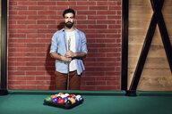 Portrait of serious man at billiard table - ZEDF02076