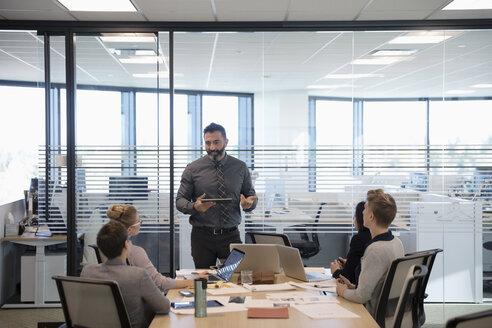 Businessman leading conference room meeting - HEROF31993