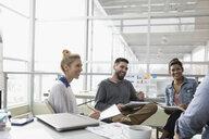 Smiling creative designers brainstorming in office meeting - HEROF32131