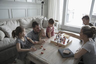 Young family playing game in living room - HEROF32146