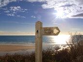 Sign post for coast path near beach, Gerrans Bay, Cornwall, United Kingdom - JUIF00577