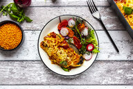 Aubergine lasagne on a plate with mixed salad - SARF04190
