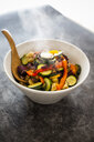 Mix of cooked vegetables in bowl, steaming - GIOF05878