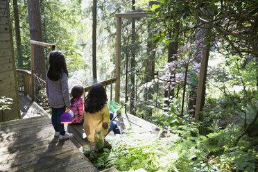 Sisters on balcony in woods - HEROF32180