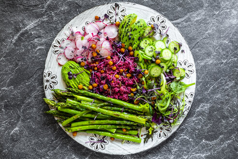 Plate of springtime salad with green asparagus, red quinoa, avocado, red radishes, cucumber and sprouts - SARF04206