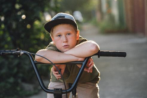 Portrait of boy with bmx bike on road - VPIF01200