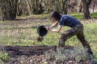 Man ploughing bed - NDF00873