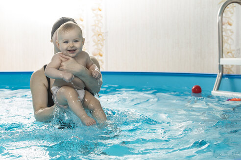 Baby swimming, mother with daughter in swimming pool - VGF00274