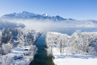 Germany, Upper Bavaria, Kochel, Aerial view of Lake Kochel in winter, Herzogstand and Heimgarten in the background - LHF00627