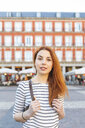 Spain, Madrid, Plaza Mayor, portrait of redheaded young woman with nose piercing - WPEF01452
