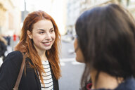 Portrait of redheaded young woman with nose piercing spending time together with her friend in the city - WPEF01458