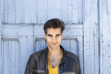 Portrait of smiling man wearing leather jacket - AFVF02698