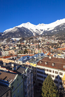 Austria, Tyrol, Innsbruck, Panoramic views of the city with snow-capped Alps in background - FLMF00166