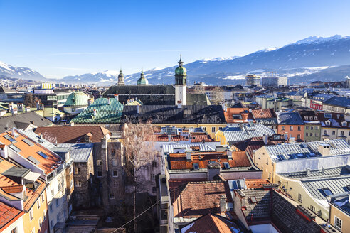 Austria, Tyrol, Innsbruck, Panoramic views of the city with snow-capped Alps in background - FLMF00169