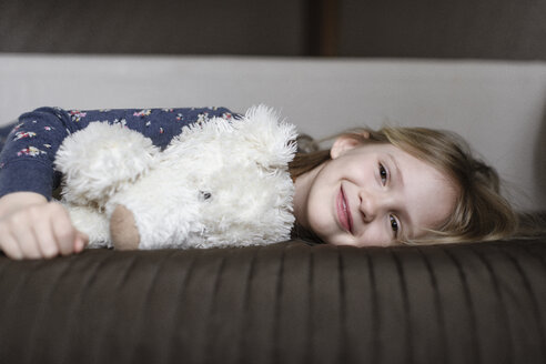 Portrait of happy little girl with white teddy bear - EYAF00079