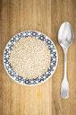 Bulgur on plate, spoon - GIOF05930
