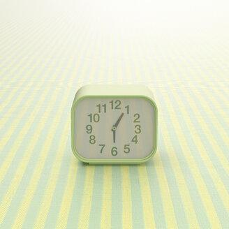 3D rendering, Alarm clock on striped background - UWF01511