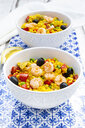 Paella with rice, bell pepper, tomato, artichoke, pea, black olive, curcuma and shrimps - LVF07938