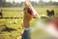 Redheaded girl in field with kite - GAF00111