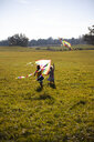 Two girls running in field with kite - GAF00120