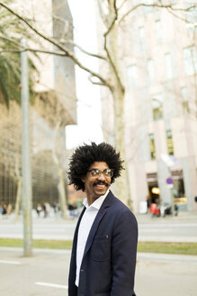 Spain, Barcelona, portrait of smiling businessman in the city - VABF02288