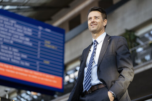 Smiling businessman at the station - DIGF06456