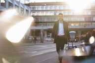 Businessman with suitcase on the move in the city - DIGF06489