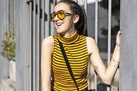 Spain, happy teenage girl in the city in summer - ERRF00853
