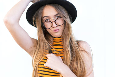 Portrait of teenage girl wearing hat and glasses - ERRF00877