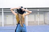 Rear view of teenage girl wearing hat - ERRF00880
