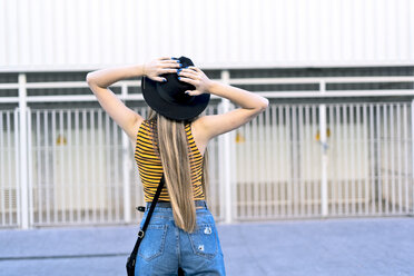 Rear view of teenage girl wearing hat - ERRF00880