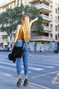 Spain, teenage girl hailing a taxi - ERRF00883