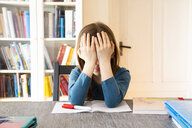 Frustrated girl with homework - LVF07944