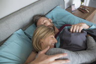 Affectionate couple cuddling in bed - HEROF33775