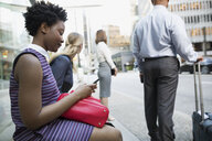 Business people waiting at city bus stop - HEROF33919