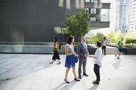 Business people talking in city - HEROF33925