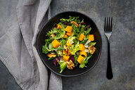 Bowl of mixed green salad with hokkaido pumpkin and walnuts - LVF07951