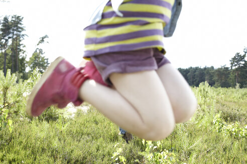 Legs of a girl jumping in nature - AMEF00054