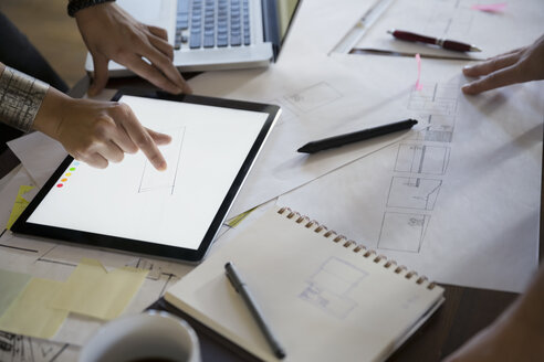 Designers with digital tablet and plans - HEROF34249