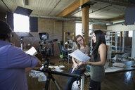 Creative business people preparing to film video tutorial - HEROF34264