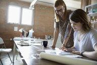 Designers using digital tablet in office - HEROF34297