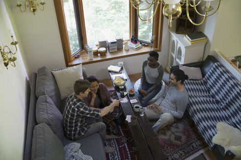Couples playing cards in living room - HEROF34348