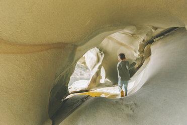 Little boy exploring sandstone caves - CMSF00005