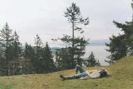 Woman relaxing in nature, lying on grass - CMSF00014