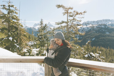 Mother holding her baby son on an observation deck, looking over Squamish, Canada - CMSF00029