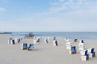 Germany, Sylt, North Sea, sandy beach with hooded beach chairs - MKFF00492