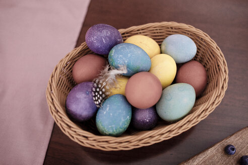 Dyed Easter eggs in a basket - KMKF00809